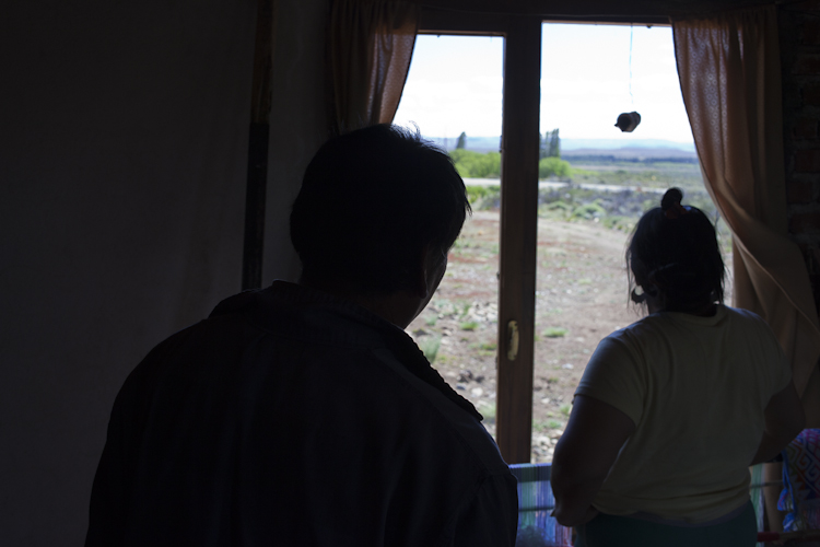 Atilio Curiñanco and Rosa Nahuelquir seen inside their house in