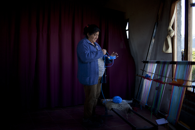 Rosa Nahuelquir weaving the traditional Mapuche fabric.